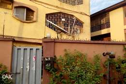 Massive three bedroom flat (up) to let in Ago Palace Way, Okota
