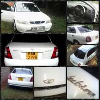 Clean white petrol import saloon vehicle (negotiable)