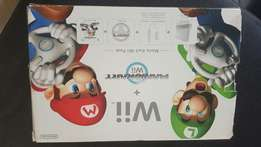 WII COMPLETE CONSOLE. Mario kart Wii pack + extra limited red remote.