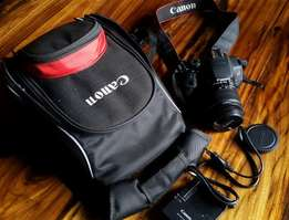 Canon 700D with 18-55mm lens and canon backpack