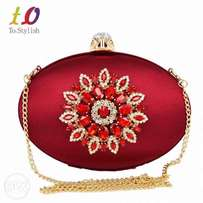 Red and Gold clutch pursue