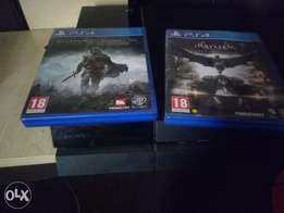 Clean PS4 for sale with a controller and 2 games.