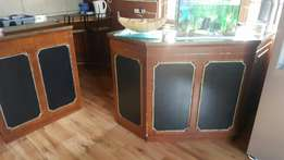 Bar table with shelves and cabinets