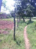 one acre land at kikambala sun n sand 2nd row from tarmac for sale