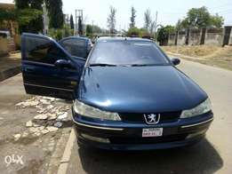 A sharp and smooth manual peaugote 406 in Abuja for sale.