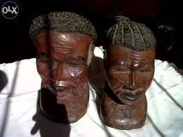 2 Handcraft Male and female head sculptures