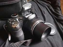 Professional Fujifilm camera wit strap & bag