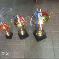 3set of gold trophies