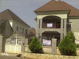 A tasteful duplex with boys quarter and a Security hours well finished