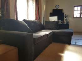 Clean, Black L-shaped Couch for sale