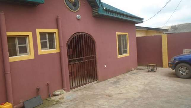 Clean renovated 2 bedroom flat all tiles floor at white house command Alimosho - image 1