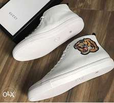 Different ankle length Gucci footwear