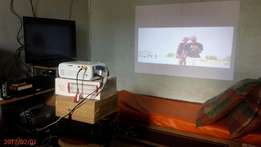 Projector that wows you,your family and friends for 15,000/=