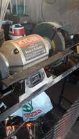 bench grinder with vice mounted on corner steel bench R450