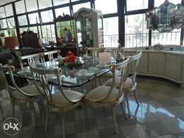 glass dining table. eight seater