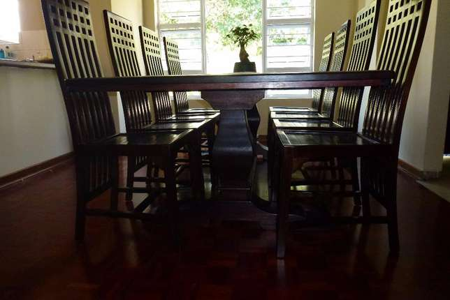 10 seater solid wood dining room table and chairs Parkmore - image 4