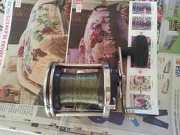 Fishing reels & grinder for sale
