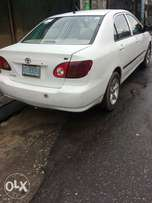 Used Toyota Corolla white CE smooth ride working fine