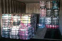 Bales of brand new clothes from variety shops