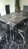 marble dining table black glass leg 6 setter