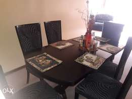 6 seater dinning table and chairs