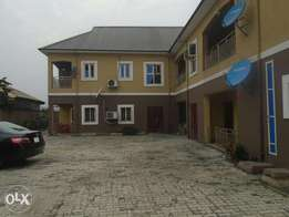 A well finish 2 bedroom flat with ample parking space at GRA phase lll