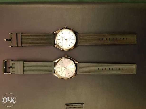 Two authentic Henley watches
