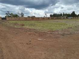 QUICK sale of a (1/4)acre of land at Kenyatta Road with ready titles