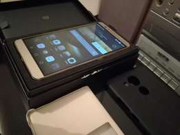 Huawai mate 7 gold 32gb for sale box and all acc