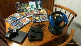 Like new PlayStation 2 with games, sing star, and racing accessories