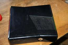 xbox 360 with 9 games and 2 controls