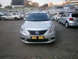 Nissan Almera 1.5 sedan silver in color 2014 model 52000km R145000