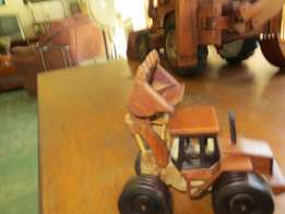 Miniature front end loader, hand made in Malawi. 20cm x 10cm