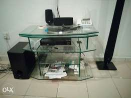 Glass TV stand for sale. It rotates.