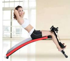 Curved tummy trimmer situp bench