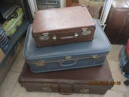3 old suitcases