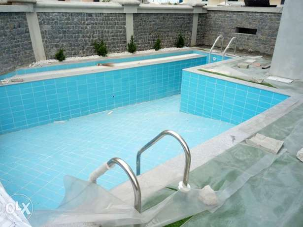 mansion with a swimming pool for sale in Osapa London Lekki - image 3