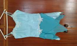 Turquoise matric boned top and skirt