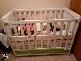 Brand new baby cot with mattress and duvet