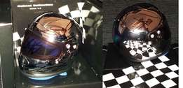 Official Minichamps F1 1/2 scale chromed helmet signed by all drivers.