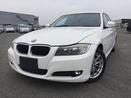 BMW 320i with alloy rims white colour