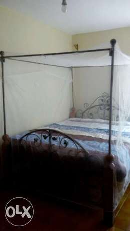 5 feet by six ft mahogany stands bed complete with unused HD bonded m Westlands - image 1