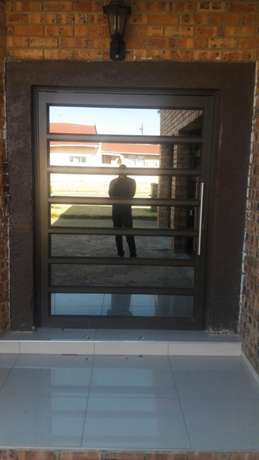 Aluminium doors and windows. Retractable security doors and barriers Secunda - image 1