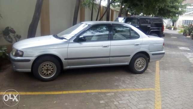 Selling Above Nissan Sunny B15, KAX 680B,Silver in Colour,Very Clean Langata - image 6