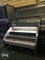 Curved glass self serve counter with hot plates