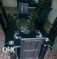 Padded 6 seater glass dining table