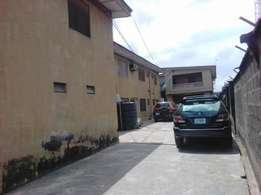 Awoof Solid block of 8flats off Holy Saviour college rd Isolo For Sale