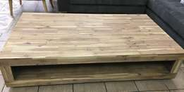 Never been used solid acacia wood coffee tables. Retails from R6299.