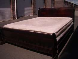 Queen Restonic mattress and heavy wooden sleigh bed and base for sale