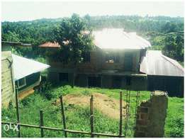 Prime Plot(85×130) for sale at kisii masiba with 3 houses